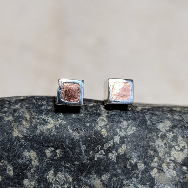 copper in silver cube studs