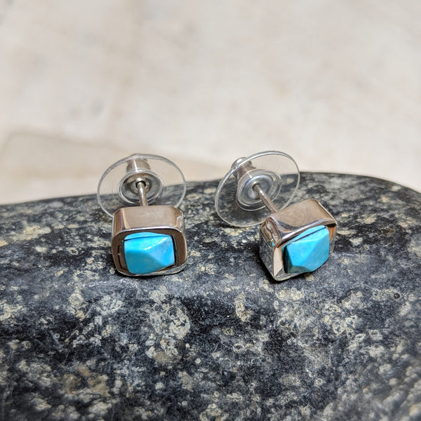 side view of faceted earrings with turquoise