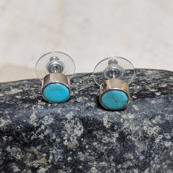 side view of circle studs in turquoise