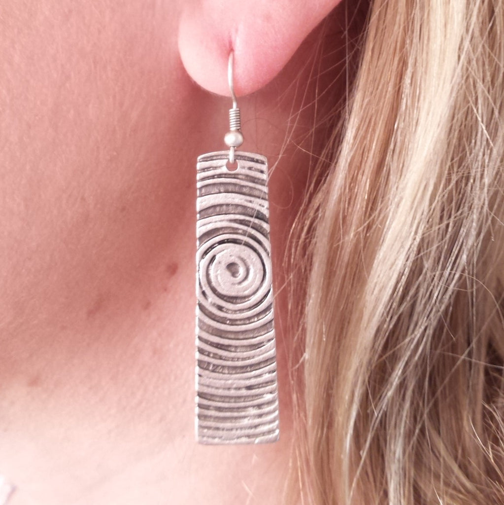 woodcut earring on model