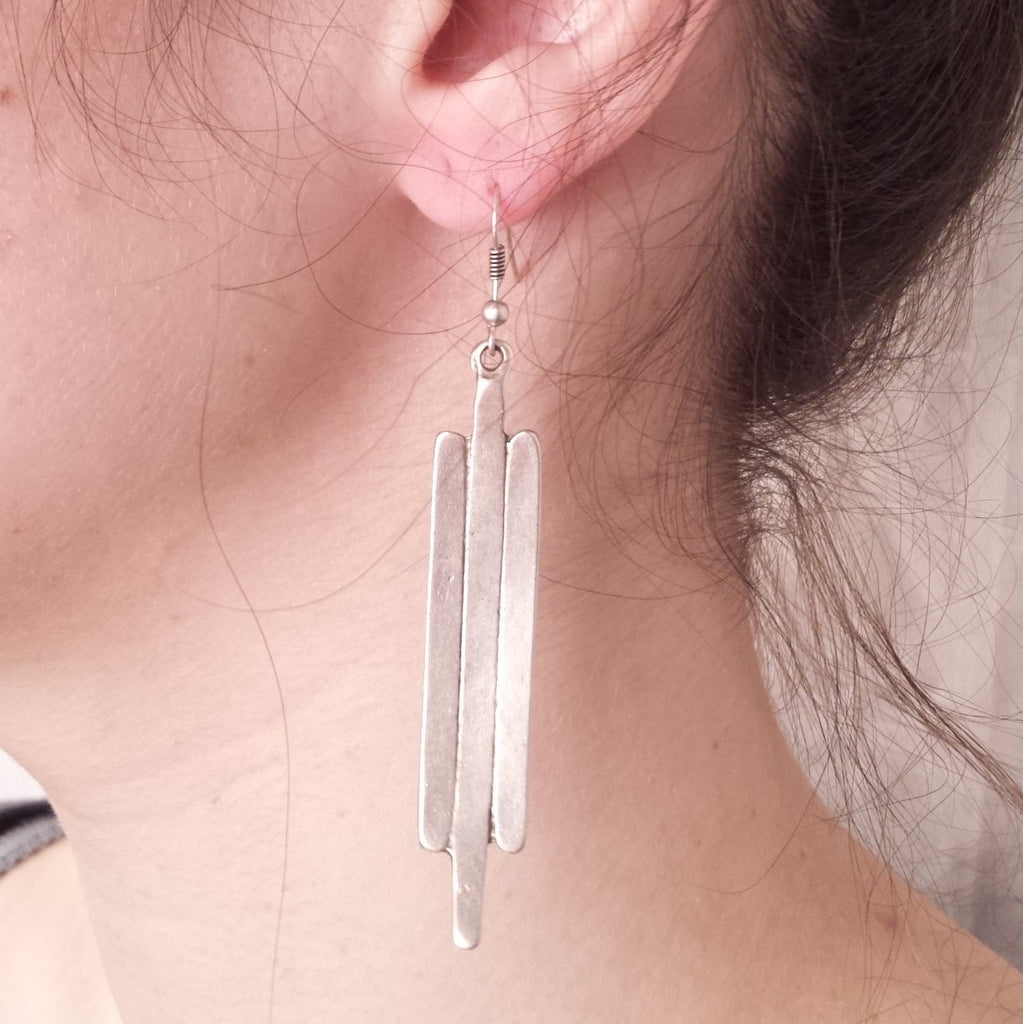 Wing Earrings on model