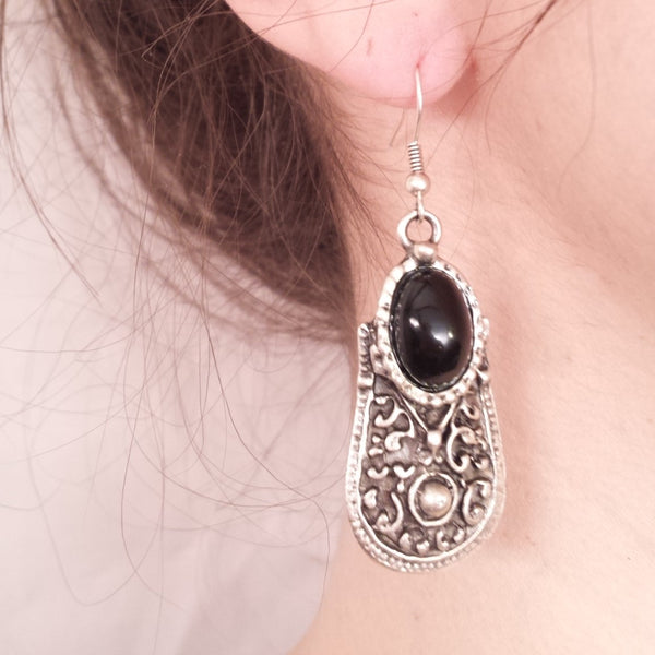 Defense Earrings in Black on model