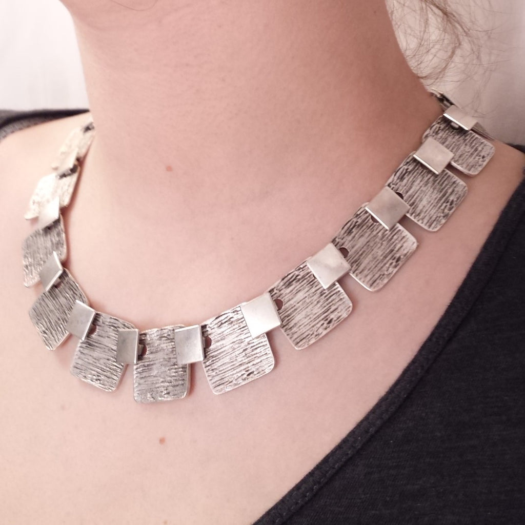 toast necklace on model
