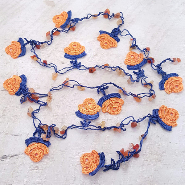 Orange and navy blue flowers.