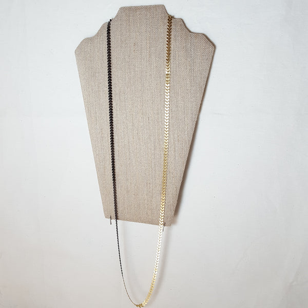 long gold arrow necklace with black