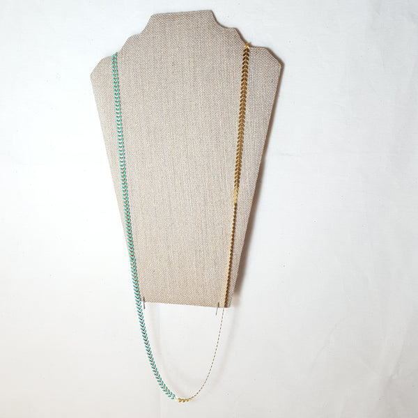 long gold arrow necklace with turquoise
