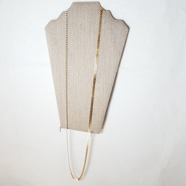 long gold arrow necklace with white