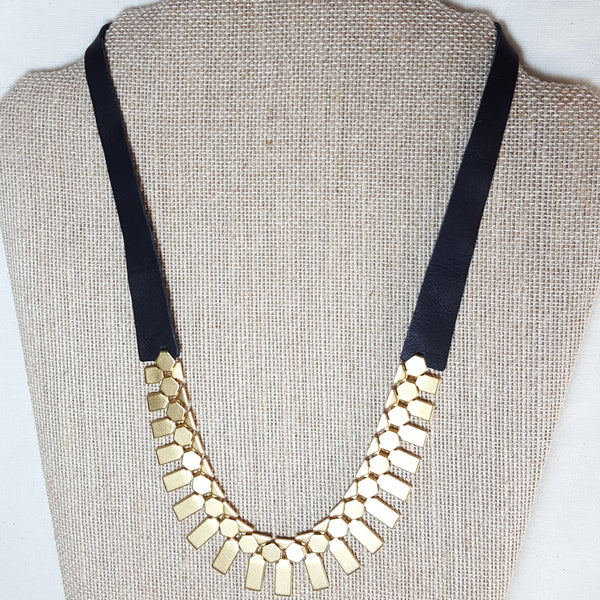 gold geometric necklace with black leather