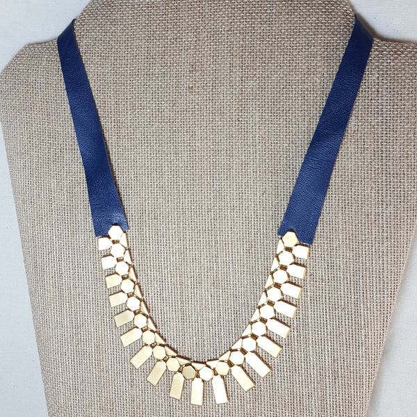 gold geometric necklace with blue navy leather