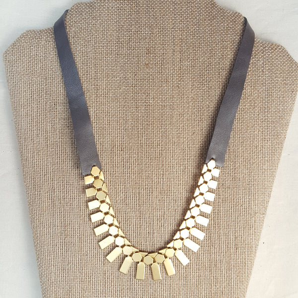 gold geometric necklace with grey leather