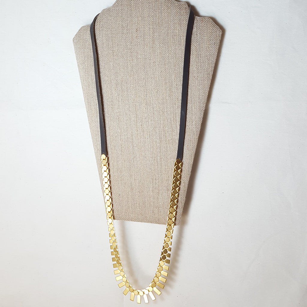 long gold geometric necklace with brown leather