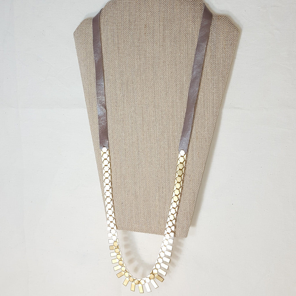 long gold geometric necklace with brown leather mocha tone