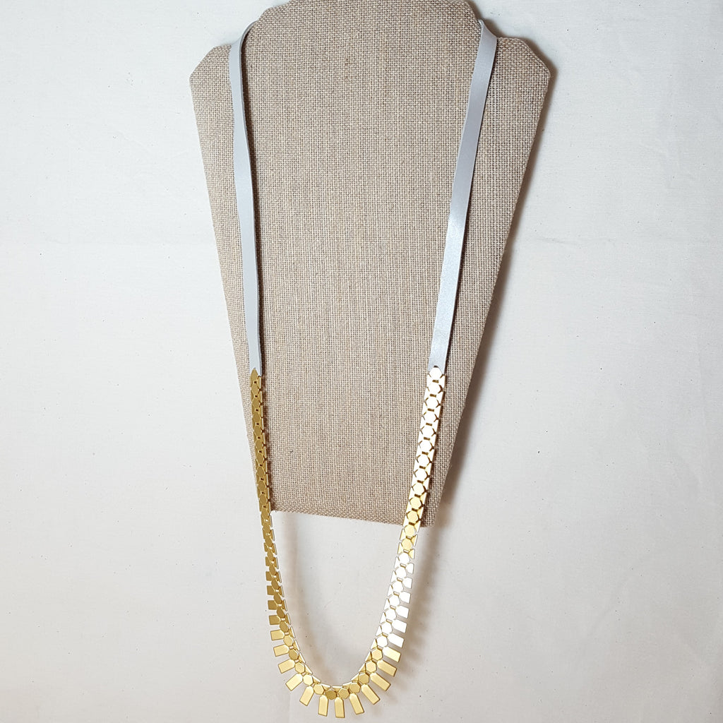 long gold geometric necklace with pearl white leather
