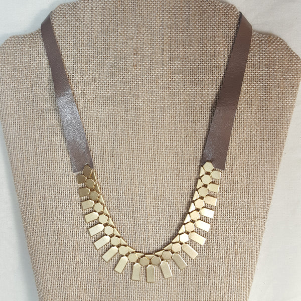 gold geometric necklace with mocha brown leather