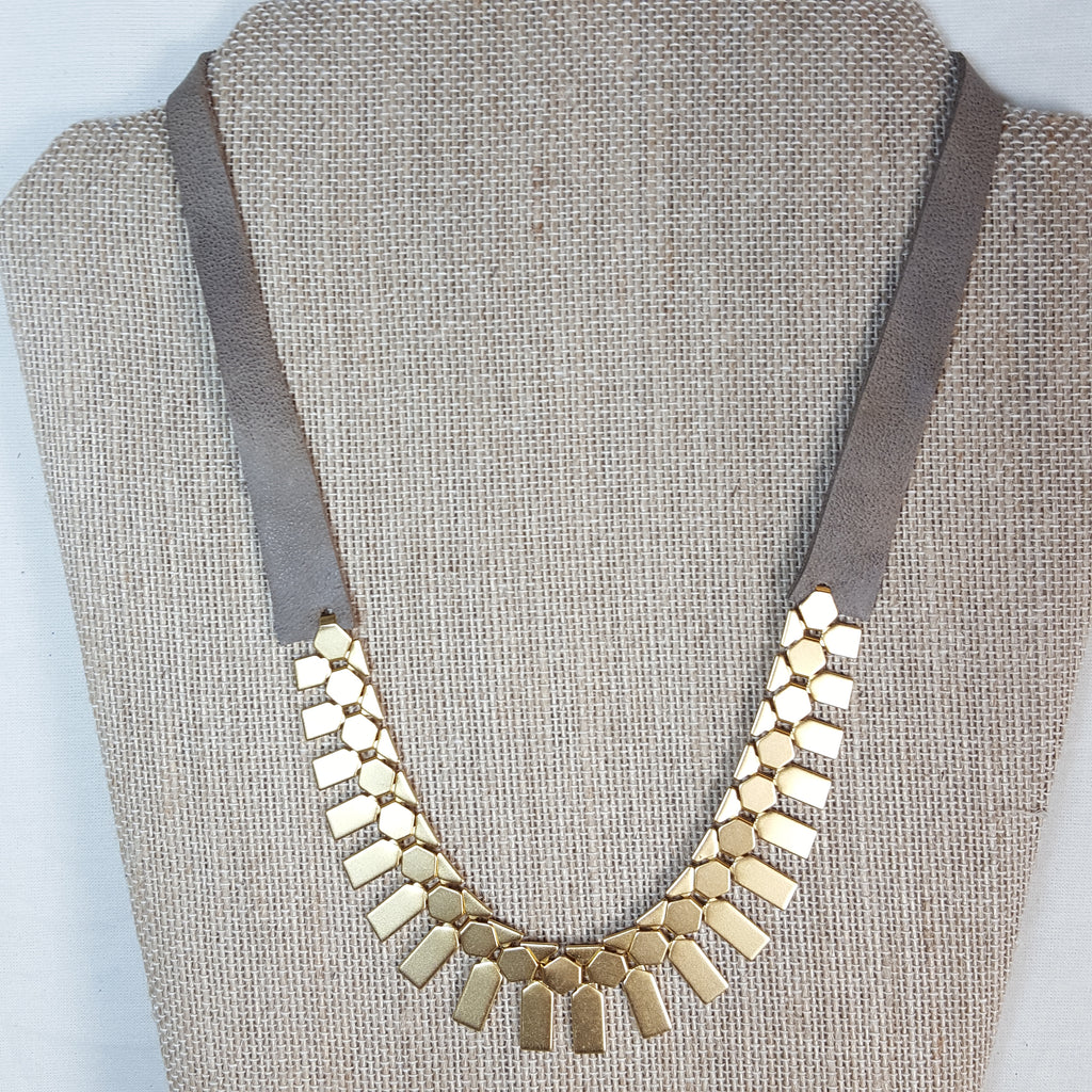 gold geometric necklace with taupe brown leather