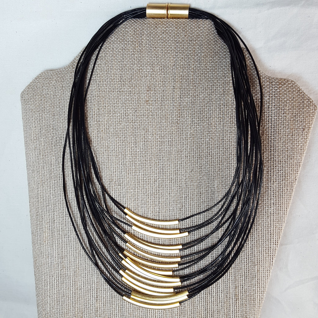 gold stack necklace with black leather strands
