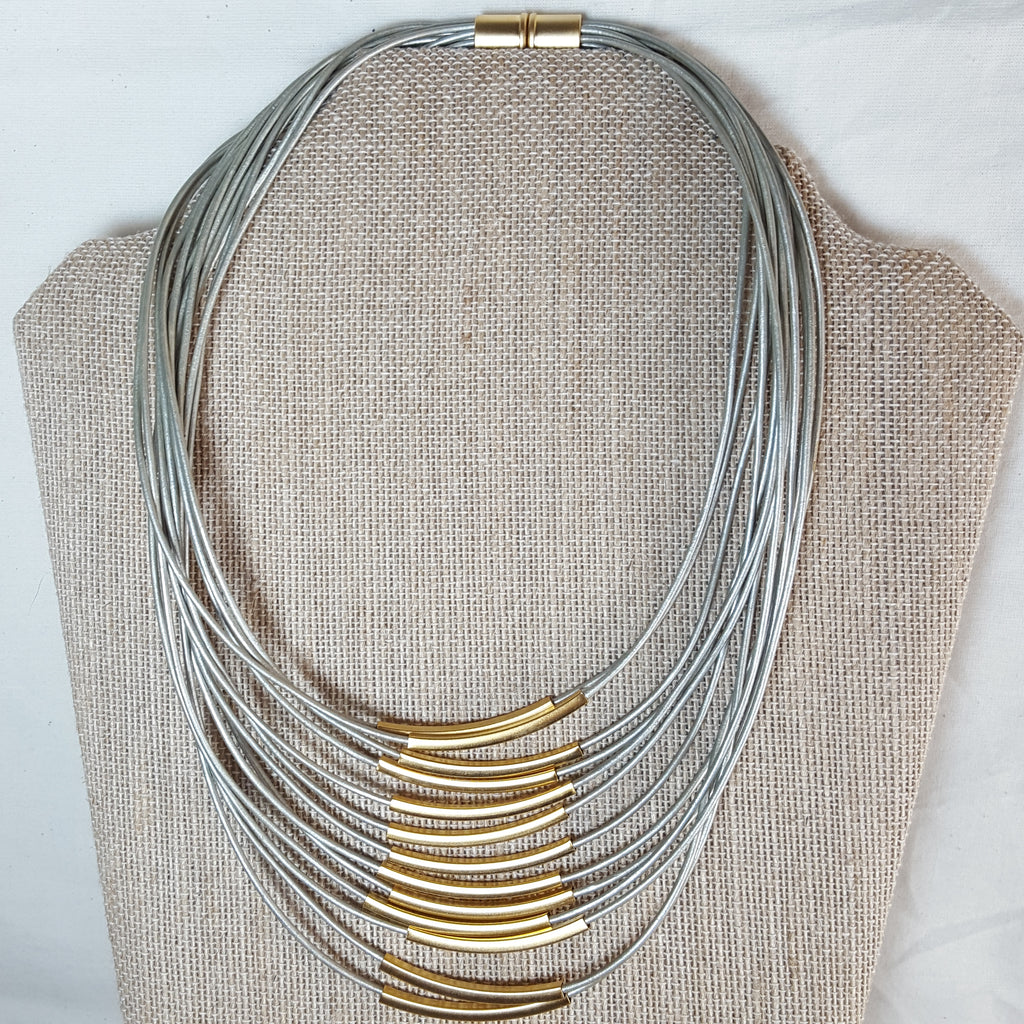 gold stack necklace with grey leather strands