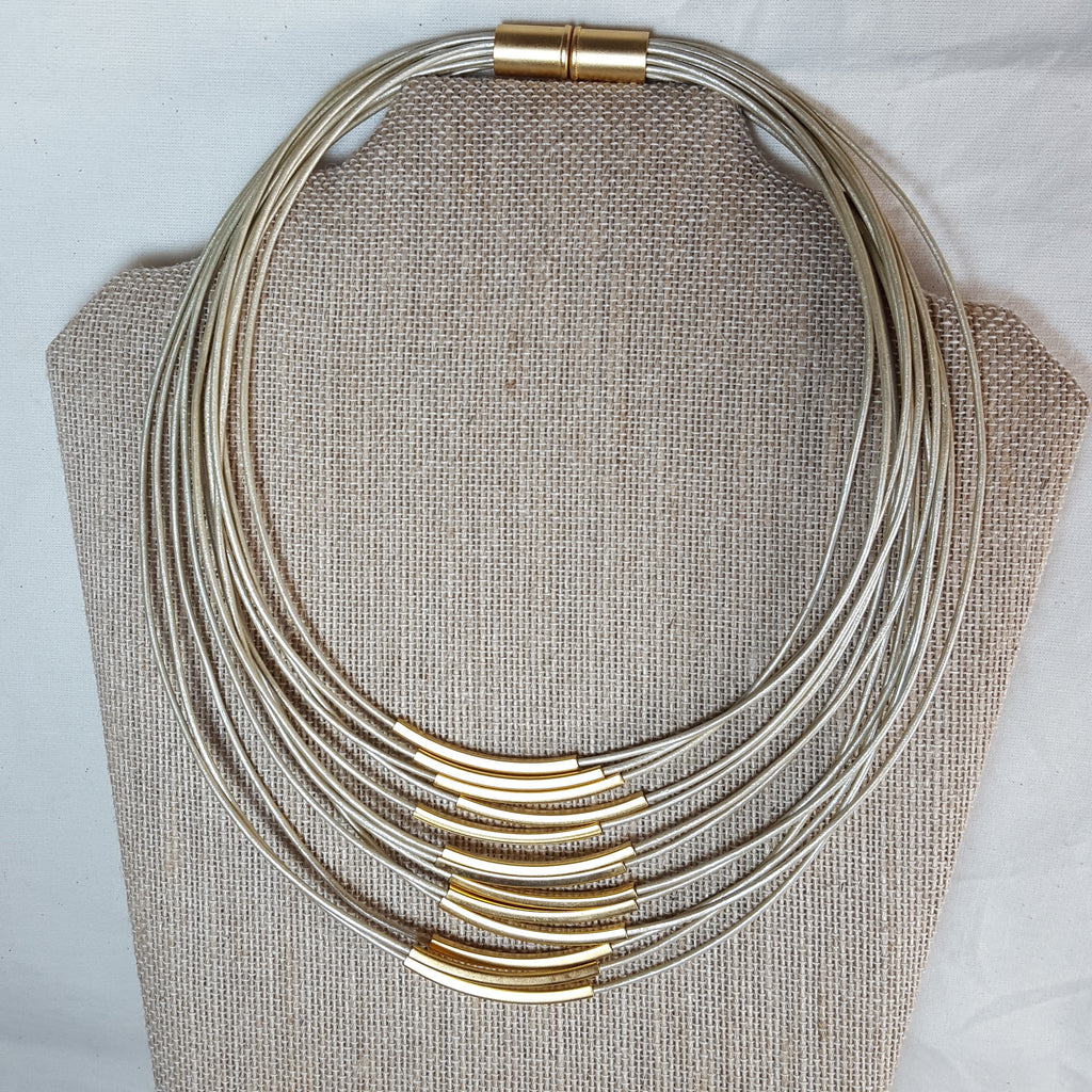 gold stack necklace with taupe brown leather strands