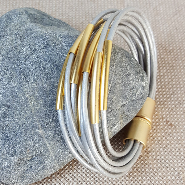 Gold tubes bracelet with grey metallic leather