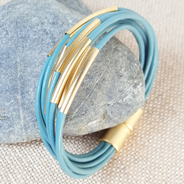 Gold tubes bracelet with turquoise leather