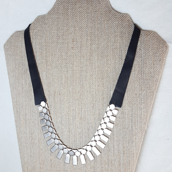 silver geometric necklace with black leather