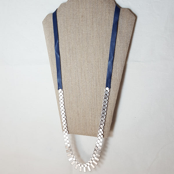 long silver geometric necklace with navy blue leather