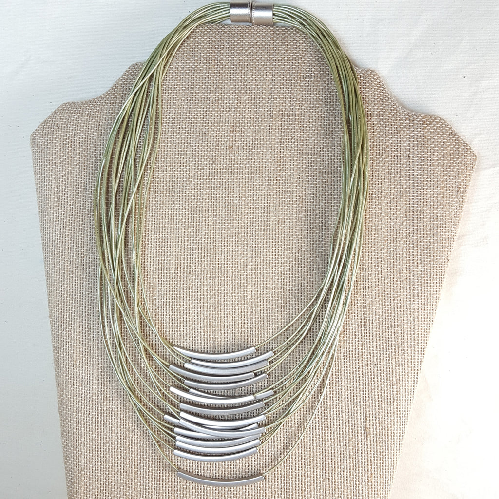 silver stack necklace with green leather strands