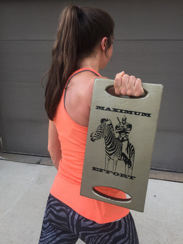 Olivia Crusoe, a bodybuilder, powerlifter, and fitness model, with her custom 30# ruck plate from SHplates.