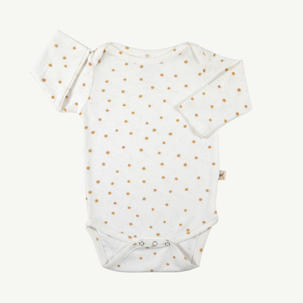 'magic flakes' organic onesie