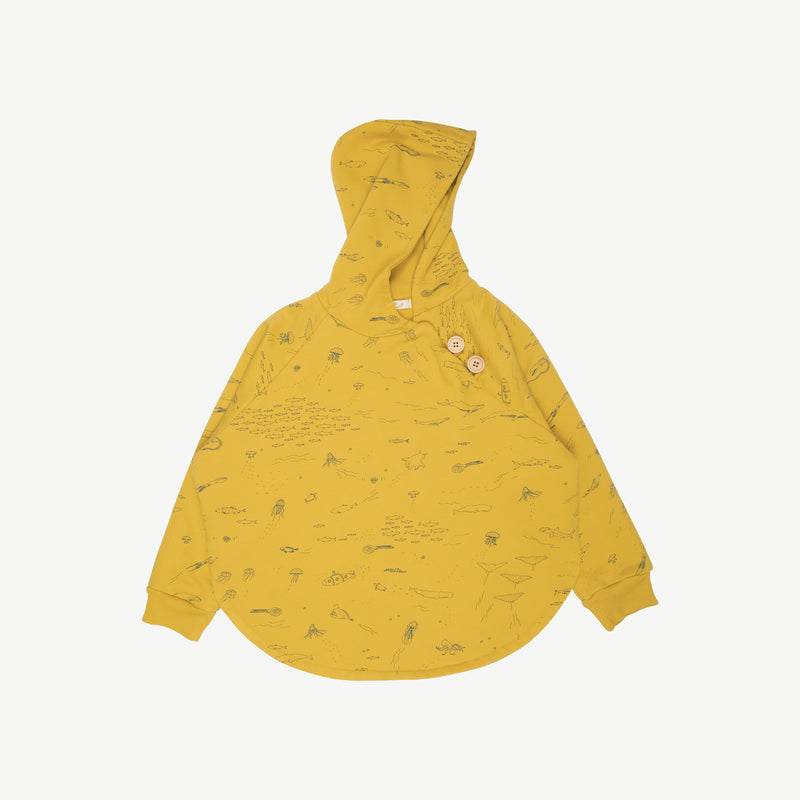 'the story' mustard	poncho