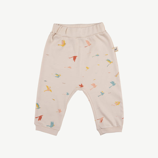 'tropical birds' pink tint baggy pants