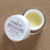 Ivadore eye balm image with lid off. Natural colour smooth balm. Active ingredients. Jojoba Oil, Q10, Shea Butter plus more.