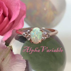Rose Gold Opal and Diamond Engagement Ring on a Crystal Ball with Pink Rose