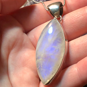 Moonstone pendant it in hand