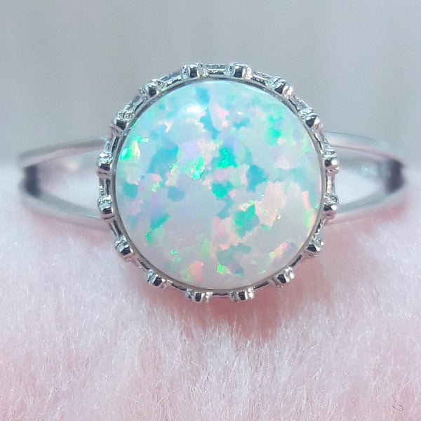 white opal engagement ring