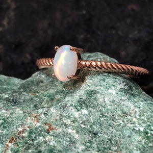 Dainty Rose Gold Engagement Ring on a Crystal AlphaVariable Jewelry