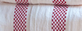 "Charvet Éditions ""Lustucru"" (Red), White woven linen tea towel. Made in France."