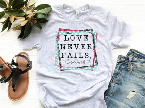 Love Never Fails -- Bella Canvas Crewneck Tee Super Soft Ash Grey Gray Trendy T-shirt Sizes XS-XXL