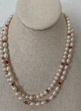 Ruby with double strands of white pearls and gold