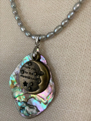 "Paua Shell with ""I love you to the moon and back"" charm strung on pearls"