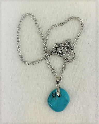 Turquoise stone on silver chain