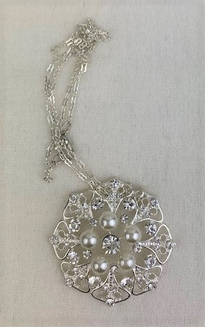 Crystal, silver and white pearl centerpiece on silver chain