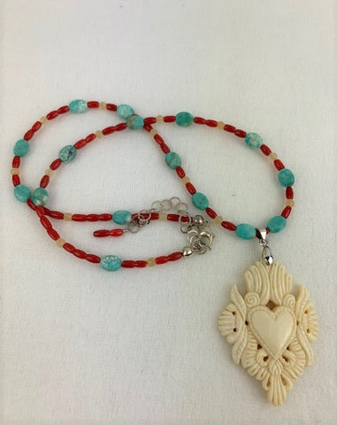 Bone carved heart strung with turquoise, red coral and yellow calcite
