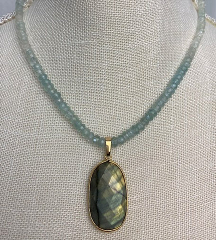 Faceted labradorite with faceted aquamarine and gold