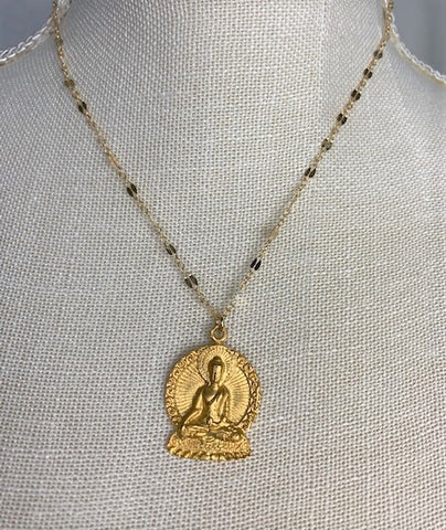 Enlightened gold Buddha on gold chain
