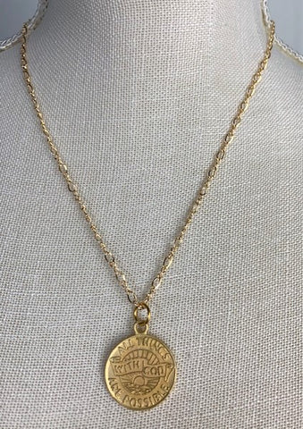 "Gold ""With God, all things are possible"" medallion on gold chain"