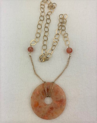 Peach moonstone disk with gold chain