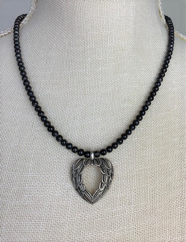Silver angel wing heart with black onyx and sterling silver