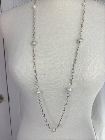 Long sterling silver chain with white pearls