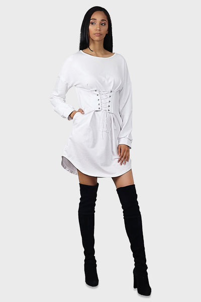 lace up white dress with sleeves, dolphin hem and side pockets on model front view